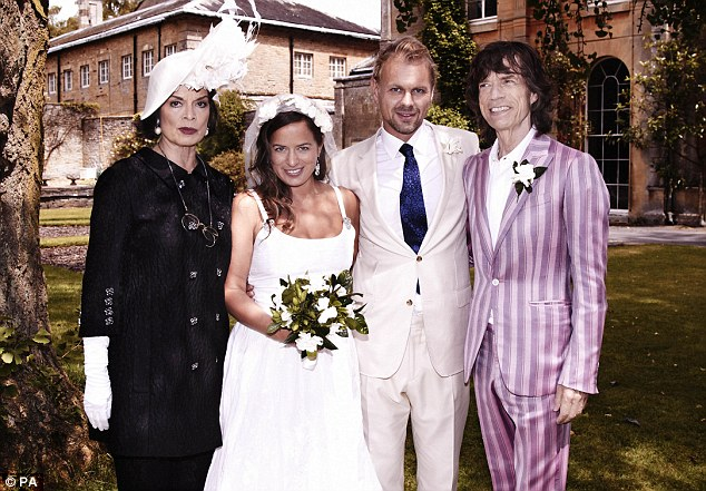 Mick Jagger in violet stripe suit