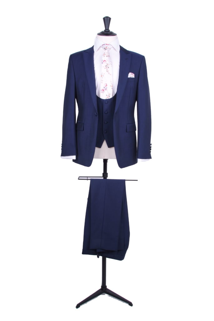 royal blue suit with scoop waistcoat and floral tie
